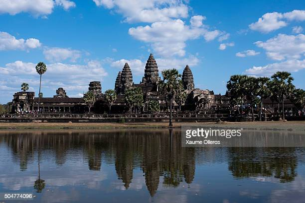 Angkor Wat temple gets reflected on a lake on January 1 2016 in Siem Riep Cambodia Angkor was the capital city of Khmer Empire which flourished from...