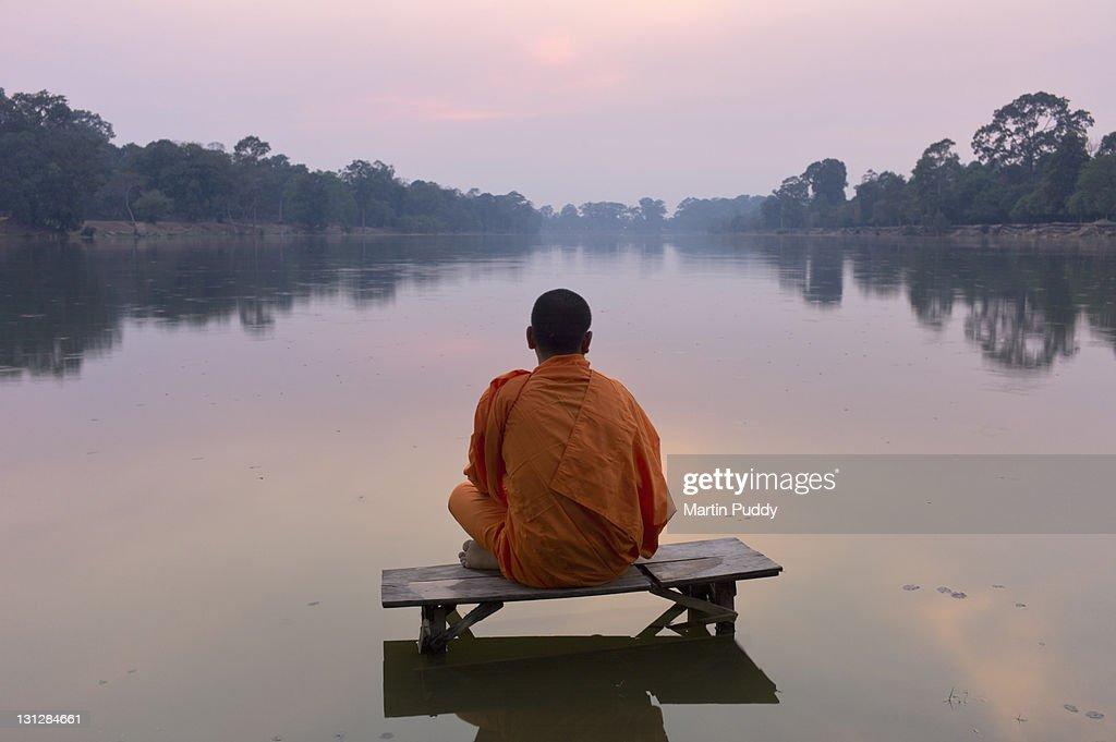 Angkor Wat,Buddhist monk at sunset : Stock Photo
