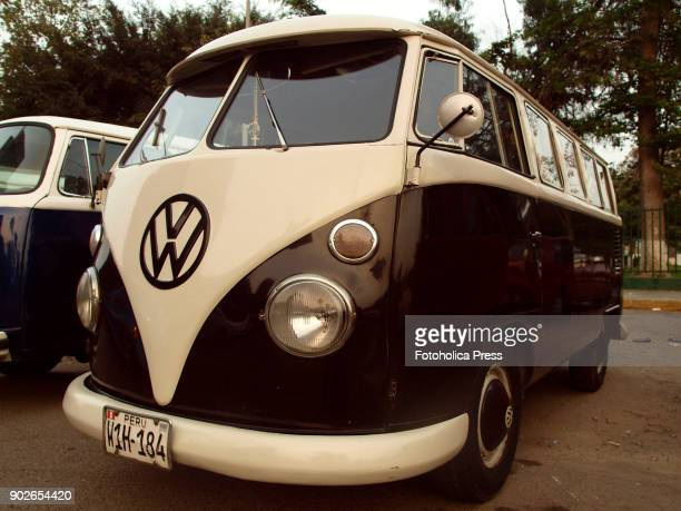 Angle view of a brown and white Volkswagen split T1 15 windows Brazilian Kombi