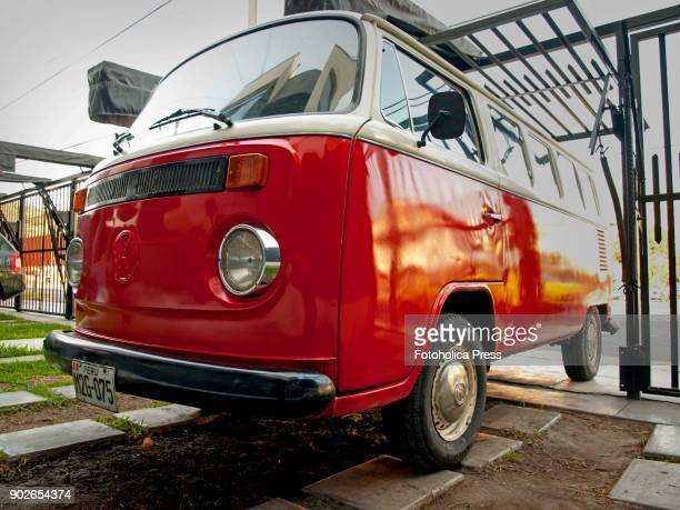 Angle view of a red and white Volkswagen T2 14 windows Brazilian Kombi