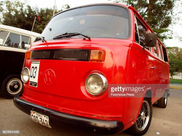 Angle view of a red Volkswagen T2 14 windows Brazilian Kombi