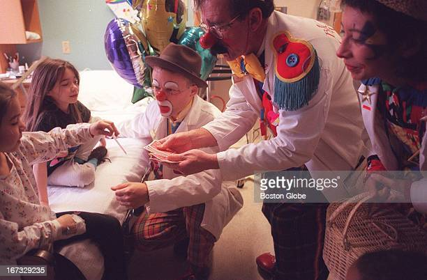 Anglea Williams left and her sister Stacia Williams right are entertained by the Big Apple Circus clowns in their room at Children's Hospital The...