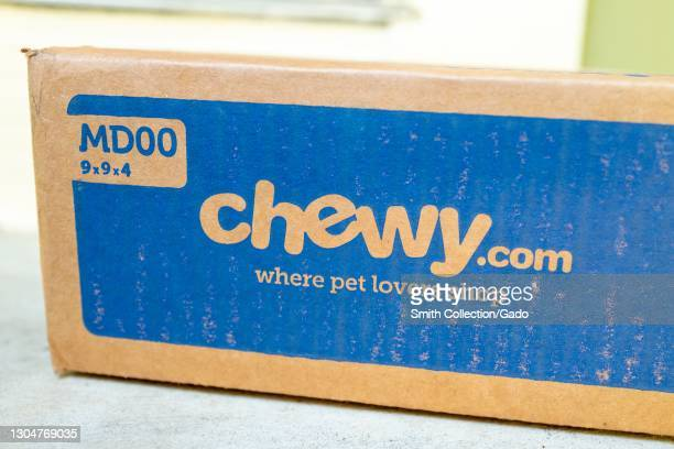 Angled close up of a box from pet-product online retailer Chewy, resting on a light-colored countertop, February 17, 2021.
