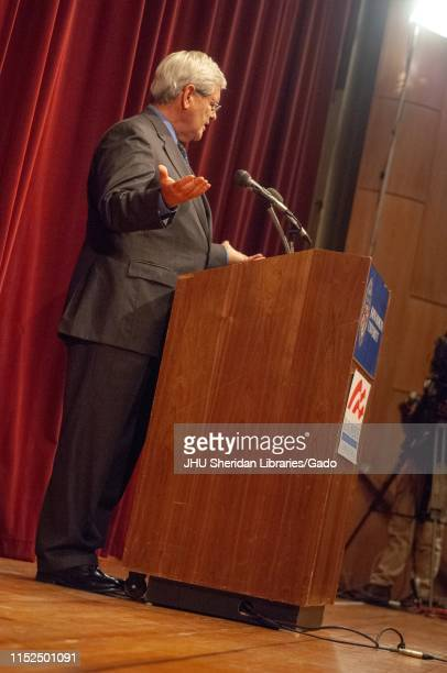 Angled fulllength profile shot of politician Newt Gingrich speaking from a podium during a Milton S Eisenhower Symposium Homewood Campus of Johns...