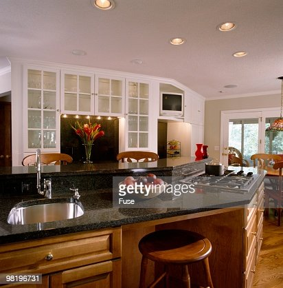 Angled Kitchen Island With Sink And Stovetop Stock Photo | Getty ...