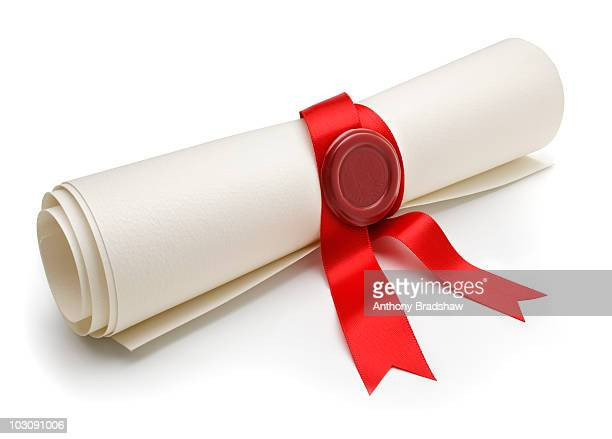 Angled view of scroll with red ribbon and seal
