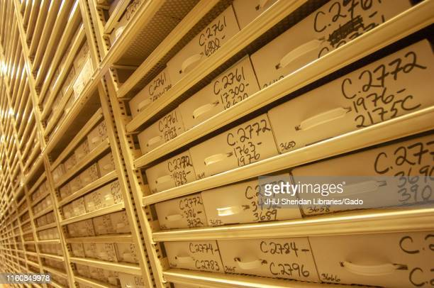 Angled view of tall stacks of cataloged file boxes, in a Milton S Eisenhower Library storage facility, at the Johns Hopkins University, Baltimore,...