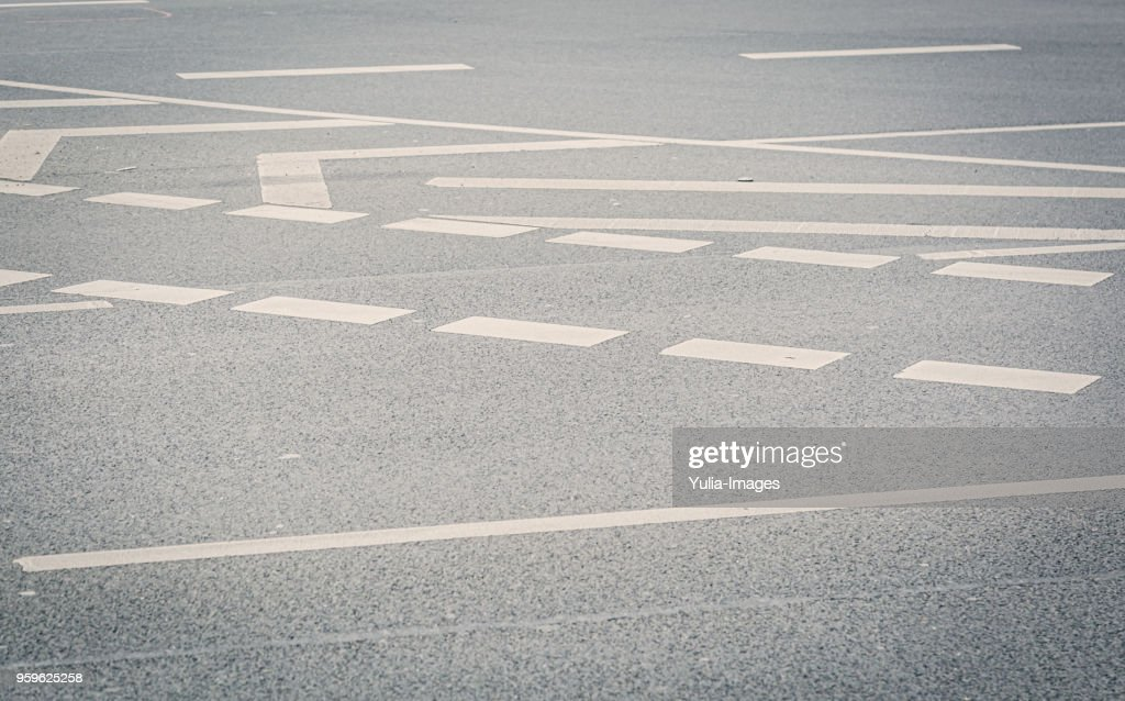 Angled view of wide street covered with markings : Stock-Foto