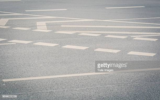 Angled view of wide street covered with markings