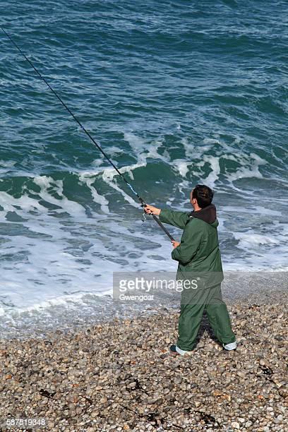 Angler at seaside