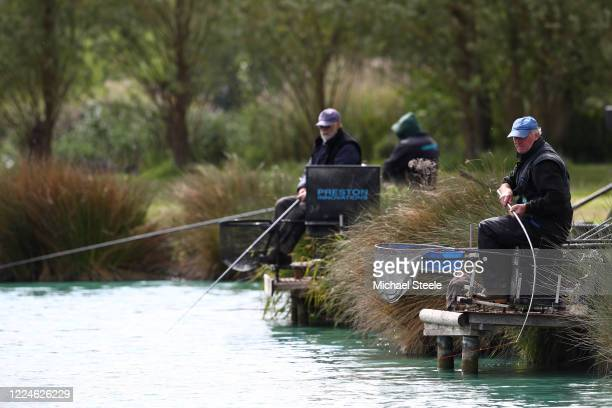 A angler casts at Acorn Fisheries on May 13 2020 in Kingston Seymour Somerset England The prime minister announced the general contours of a phased...