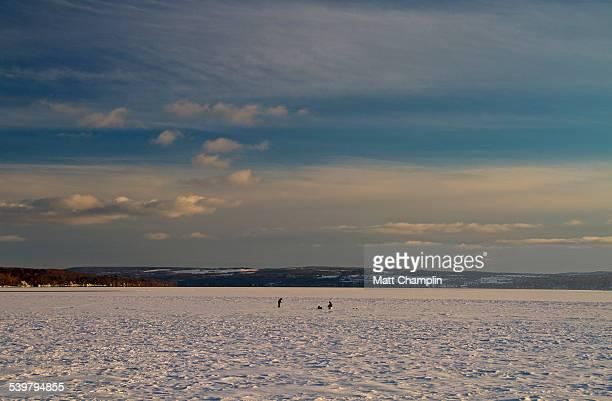 angler ice fishing on skaneateles lake - skaneateles lake stock pictures, royalty-free photos & images