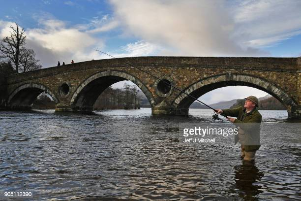 Angler Kenny Docherty casts from the banks of the river Tay during the traditional opening of the river Tay Salmon Season on January 15 2018 in...