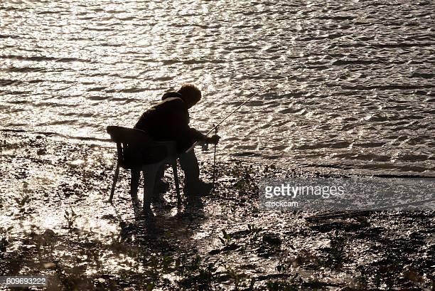 Angler on River Thames, London