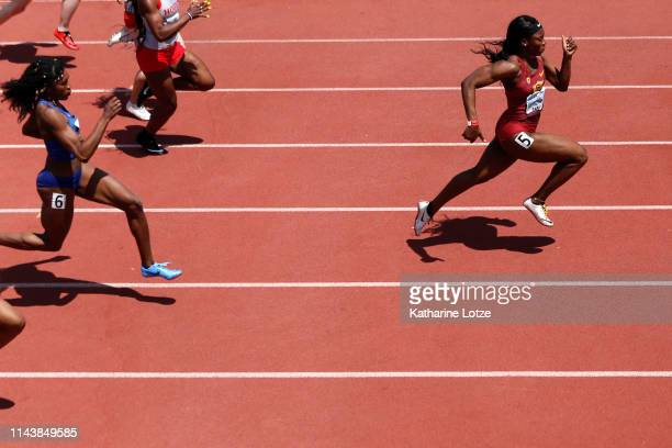 Anglerne Annelus of the University of Southern California breaks from the pack to win her heat of the prelims in the collegiate section of the...