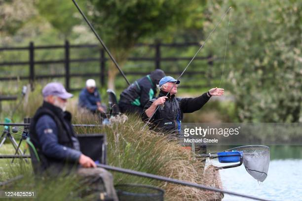 Anglers fish at Acorn Fisheries on May 13 2020 in Kingston Seymour Somerset England The prime minister announced the general contours of a phased...