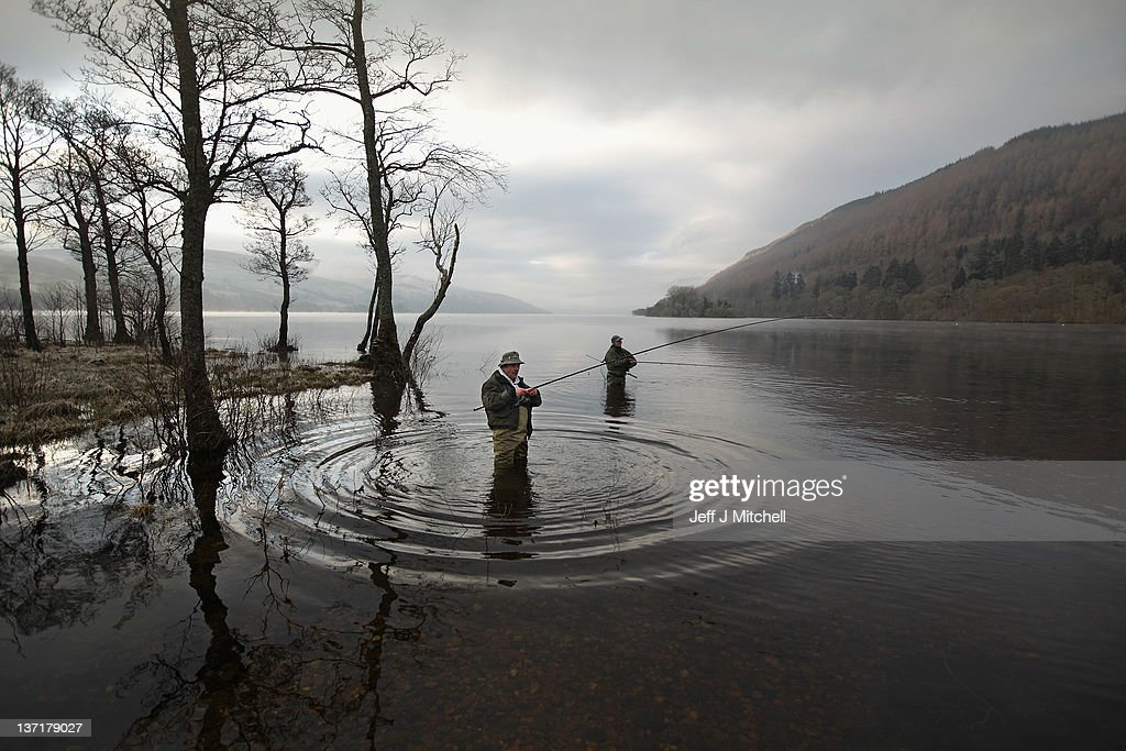 Anglers mark the opening of the salmon fishing season on the River Tay on January 16, 2012 in Kenmore, Scotland. A procession with a pipe band and anglers made its way through Kenmore at the east end of Loch Tay to mark the start of the 2012 salmon season on the River Tay