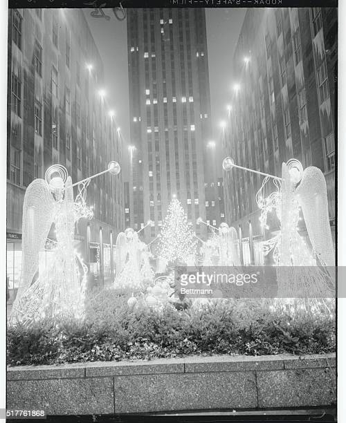 Angles called forth the Christmas season at Rockefeller Center's Channel Gardens tonight as the huge Christmas tree was officially lighted The...