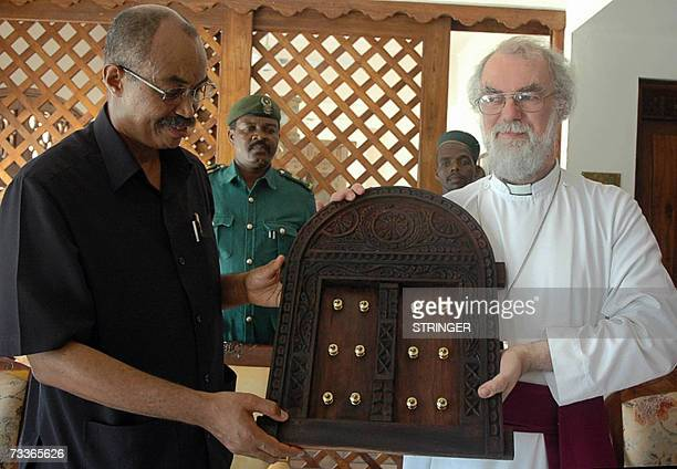 Anglican Archbishop Rowan Williams receives a traditional carving from Zanzibar President Abeid Karume upon his arrival on Zanzibar 18 February 2007...