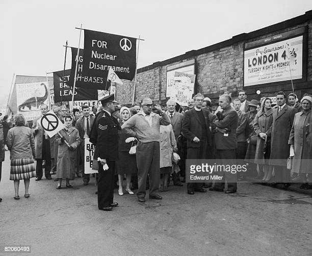 Anglican Canon John Collins one of the founders of the CND antinuclear movement heads a protest march through Scarborough in North Yorkshire at the...