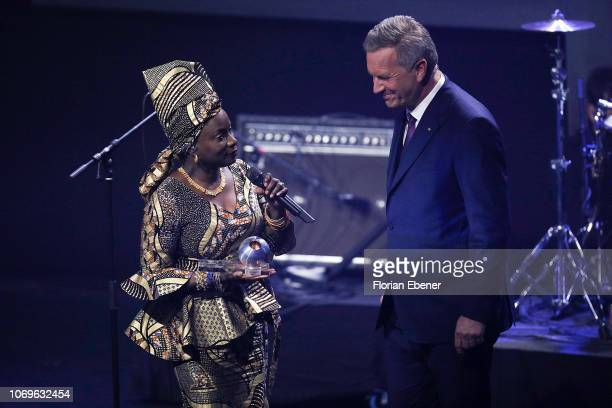 Angélique Kidjo and Christian Wulff attend the German Sustainability Award at Maritim Hotel on December 7 2018 in Duesseldorf Germany