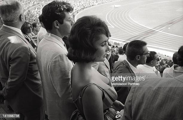 AngloAmerican actress Liz Taylor attending the Opening Ceremony of the Olympic Games with the American singer Eddie Fisher her husband Rome 25th...