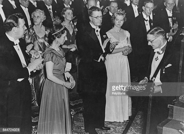 AngloAmerican poet critic and writer T S Eliot after receiving the Nobel Prize in Literature Stockholm Sweden 13th December 1948 Looking on are are...