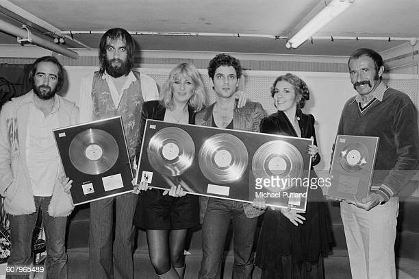 Anglo-American rock group Fleetwood Mac with awards for British sales of their albums 'Rumours' and Tusk', Wembley Arena, London, June 1980. The band...