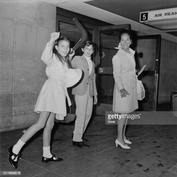 AngloIndian actress Merle Oberon at Heathrow Airport with her children Bruno and Francesca London UK 4th August 1969