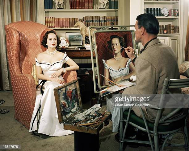 AngloIndian actress Merle Oberon having her portrait painted circa 1940