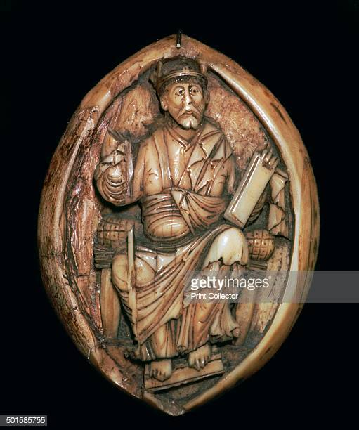AngloSaxon ivory carving of a man writing a book from the Victoria and Albert Museum's collection 10th century