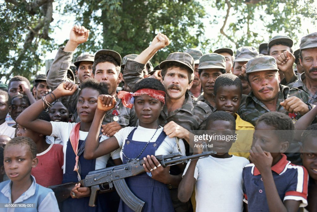 Angola, Luanda, children (7-11) and soldiers during political rally : News Photo