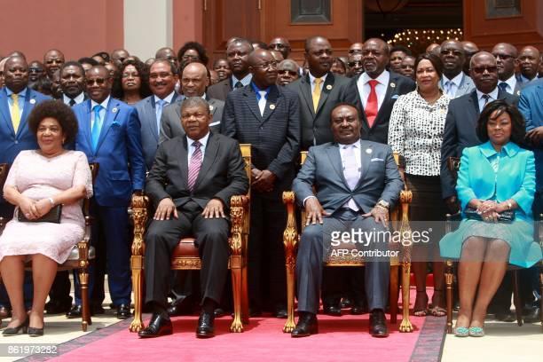 Angola newly elected president Joao Lourenco sits next to the National Assembly President Fernando da Piedade Dias dos Santos as they pose for...