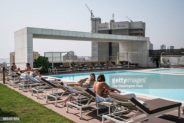 People relax beside the pool at the luxurious Epic Sana hotel located beside the de Beers building a 13story highrise in the capital A sharp decline...