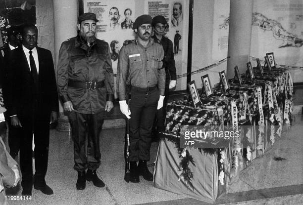 Angola President Jose Eduardo dos Santos and his Cuban counterpart Fidel Castro pay honors to the mortal remains of Cuban soldiers who fell in combat...