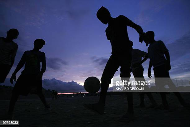 Angolan boy kicks the ball outside the Stadium of petroleum Academic in Lobito village about 20 km out of Benguela on January 14 2010 during the...