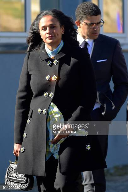 Angolan businesswoman Isabel dos Santos arrives followed by her husband Congolese art collector and businessman Sindika Dokolo to attend the start of...