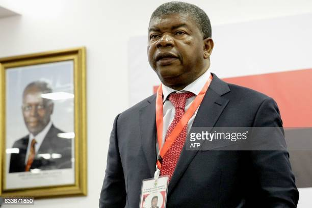 Angolan Defence Minister Joao Lourenco and Angolan president sing the party anthem during the ordinary meeting of the central committee of Angolan...