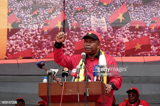 Angolan Defence Minister Joao Lourenco delivers a speech as part of celebrations marking the 60th anniversary of Angolan ruling party People's...