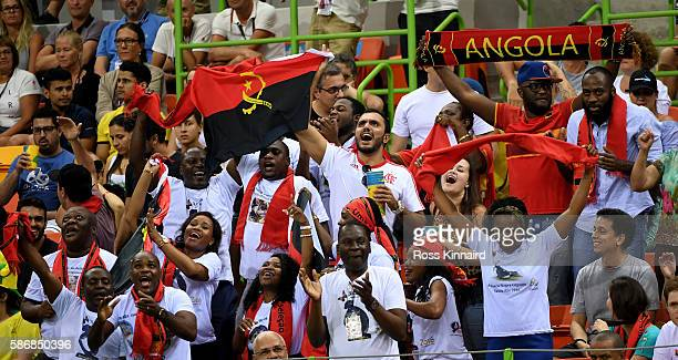 Angolan fans celebrate after the Women's Handball match between Romania and Angola on Day 1 of the Rio 2016 Olympic Games at Future Arena on August 6...
