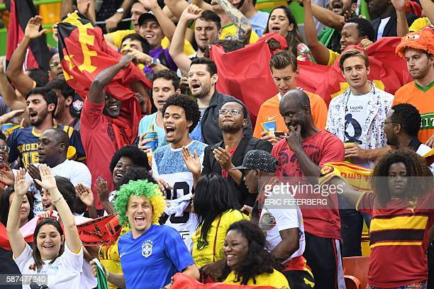 Angolan fans cheer their team during the women's preliminaries Group A handball match Angola vs Montenegro for the Rio 2016 Olympics Games at the...