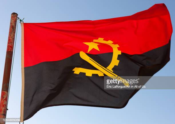 Angolan flag in the wind, Namibe Province, Tombua, Angola on November 29, 2010 in Tombua, Angola.