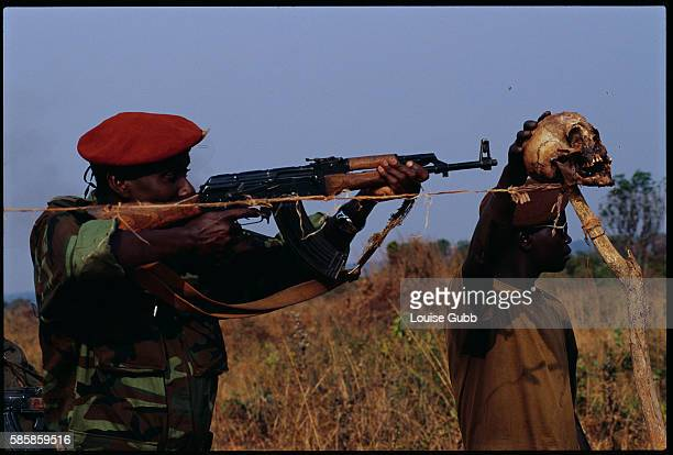 Angolan government soldiers stand guard at a roadblock that is marked with a human skull After Angola gained independence from Portugal in 1975 civil...