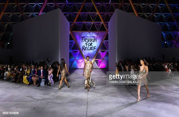 Angolan model Maria Borges and US model Bella Hadid model on May 13 2018 during the Fashion For Relief Cannes 2018 event on the sidelines of the 71st...