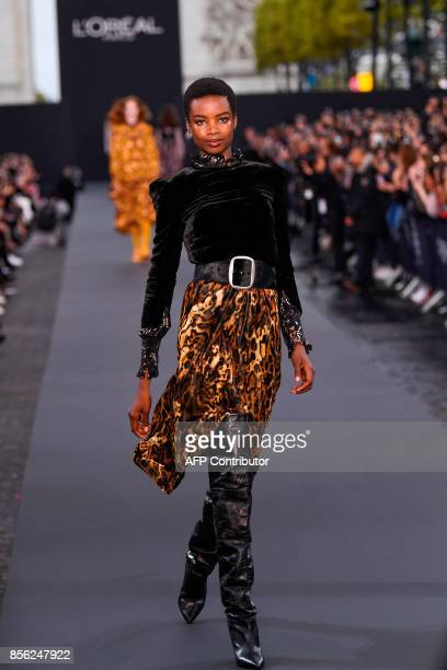 Angolan model Maria Borges takes part in the L'Oreal fashion show which theme is Paris on the sidelines of the Paris Fashion Week on a catwalk set up...