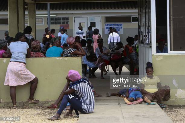 Angolan patients several stricken with malaria wait for consultations at a hospital in Luanda on February 22 2018 Heavy rains filthy conditions...