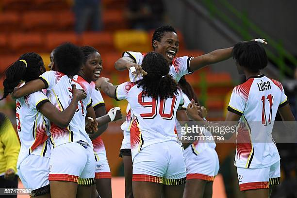 TOPSHOT Angolan players celebrate their victory at the end of the women's preliminaries Group A handball match Angola vs Montenegro for the Rio 2016...
