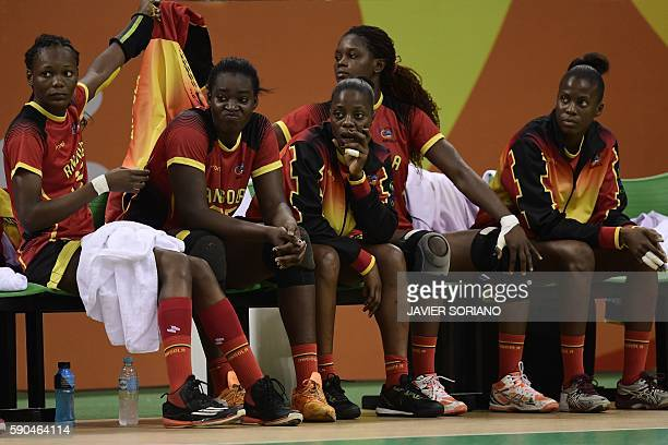 Angolan players look on during the women's quarterfinal handball match Russia vs Angola for the Rio 2016 Olympics Games at the Future Arena in Rio on...