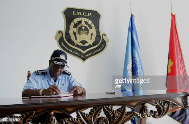 Angolan Police Commissioner Ambrosio de Lemos is seen at work in his office at the ceremony for the graduation of the third course of police sciences...