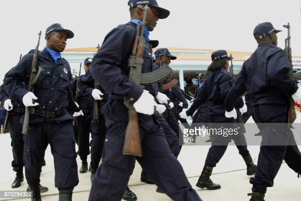 Angolan policemen are seen at a ceremony for the graduation of the third course of police sciences at the Police Academy in Benguela on April 19 2017...